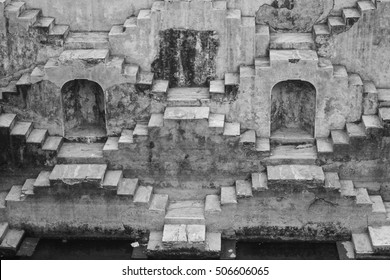 Black and white image of Panna Meena Ka Khun or the stepwells of Chand Baori, in Jaipur, India. It was built as a monument to the goddess of joy and happiness, Hashat Mata.