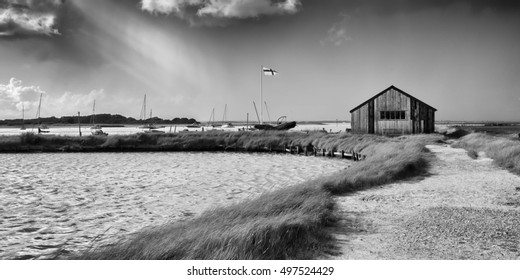 A black and white image of a passing storm on the coast