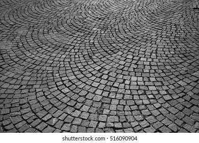 Black and White image of a paved road in Italy