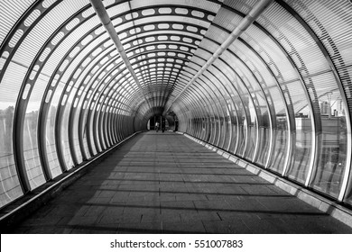 Black and white image showing Vision or concept of Pedestrian bridge during evening sunset of summer in canary wharf of London