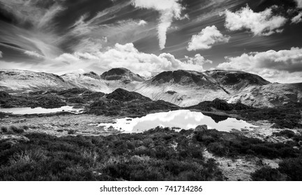 Black and white image of the summits of Green Gable, Great Gable and Kirk Fell from Hay Stacks in the English Lake District.