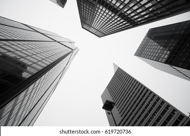 Black and white image towering Architecture and city-scape of  five Chicago buildings rising skyward Illinois USA
