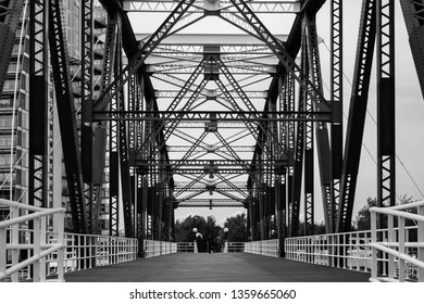 A black and white image of the view up the middle of the Detroit Swing Bridge in Salford Quays, Manchester.