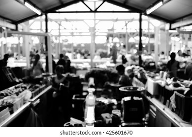 Black and white image of wet market with intentional blur effect.