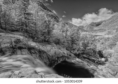 Black and white infrared long exposure photography: waterfall within Aiguestortes National Park, Vall de Boi, Lleida, Catalunya, Spain