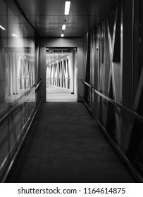 Black and white interior design of a jet bridge isolated unique photo