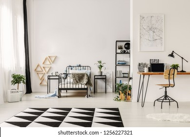 Black and white interior design of spacious kid's bedroom with workspace