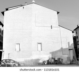 Black and white isolated house with empty illuminated wall. Useful as signboard.