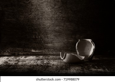 black and white jar clay pot broken On the old wood table still life picture
