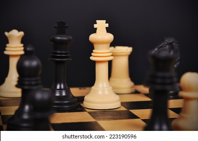 Black and White King on chess board, close up