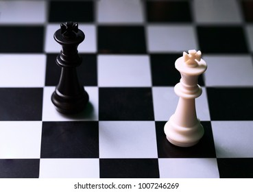 Black and white kings on chess board
