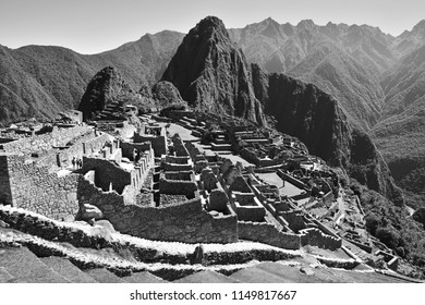 Black and white landscape of the Inca archaeological site of Machu Picchu, the lost city of the Inca, with the Urubamba river underneath, Peru.