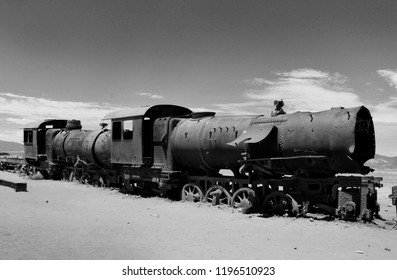 Black white landscape of large train graveyard, locomotive metal cemetery, black and white photo, Uyuni, Bolivia