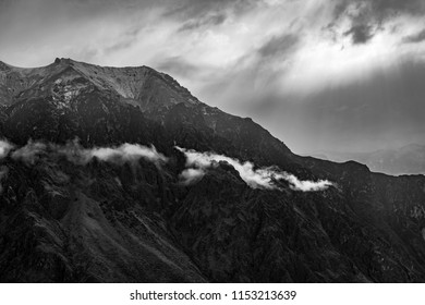 Black and white landscape photograph of the Andes mountain range traveling through the countries of Venezuela, Colombia, Ecuador, Peru, Bolivia, Chile and Argentina. South America.