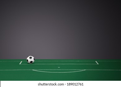 Black & White Leather Football on a fabric football pitch