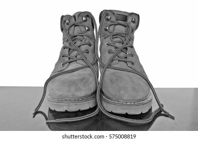 Black and white leather shoes with reflection