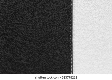 Black and white leather texture with white stitches