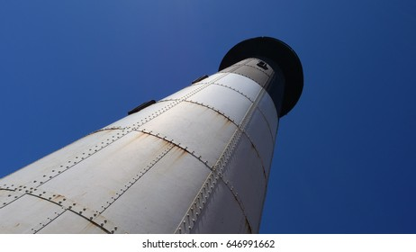 Black and white lighthouse and a clear blue sky