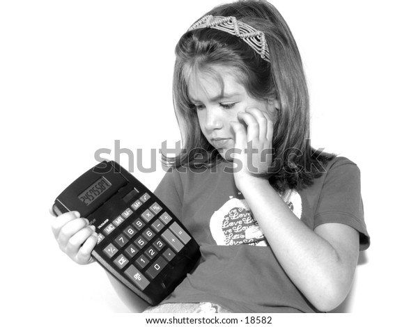 black and white of a little girl with puzzled expression and large calculator