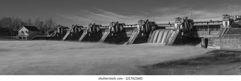 Black and white long exposure panorama photo from a dam on the river Drava near city Ptuj
