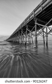 A Black and White Long Exposure Under a Pier