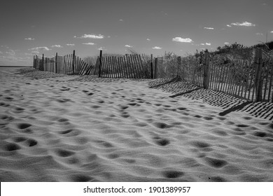 A black and white look at beach sands and fence along the sand dunes in Long Branch New Jersey.