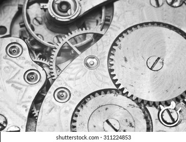 Black and white macro photo close-up view of metal clockwork. Concept eternity, teamwork