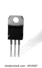 Black and white macro shot of an electronic device, isolated on white (transistor)