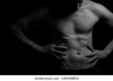 Black and white. Male. Inflated person on a black background. Body. Beauty and fashion. Sport.