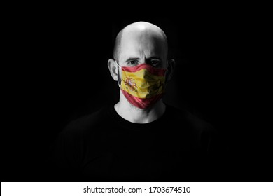 black and white man with face covered with a mask and spanish flag