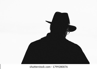black and white man with hat and glasses