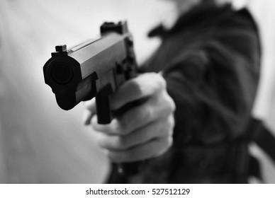 black and white man shot gun