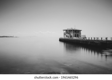 Black and white minimalist daytime long exposure with neutral density filter of Historical Moda Pier (the sign says in Turkish; Historical Fashion Pier) Caferaga, Kadıkoy, Istanbul - Shutterstock ID 1961465296