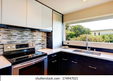 Black and white modern kitchen room with multi-color backsplash