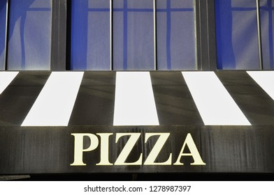 Black and white modern Pizza signage.