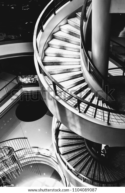 Black and white modern spiral staircase.