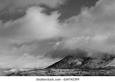 Black and white monsoon clouds covering the  Catalina Mountains in winter in Tucson, Arizona in the sonoran desert