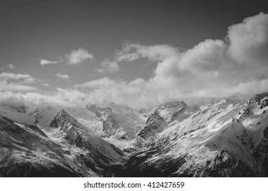 Black and white mountains in cloud. Caucasus Mountains, region Dombay.