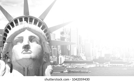 black and white new york city cityscape and skyline landmark over the hudson river. with new york statue of liberty.