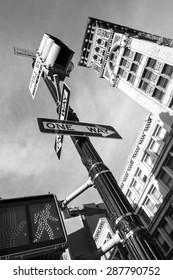 Black and white New York City traffic light and street signs from below