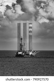 Black and white oil and gas drilling rig