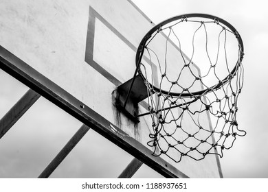 Black and white of Old basketball hoop on sky background and clouds