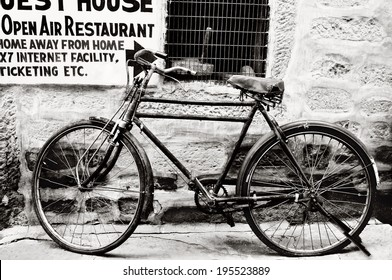 Black and white old bicycle  in front of house / Black and white old bicycle