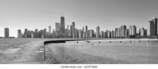 Black and white panoramic view of Chicago waterfront skyline from the Michigan Lake pier, Illinois, USA.