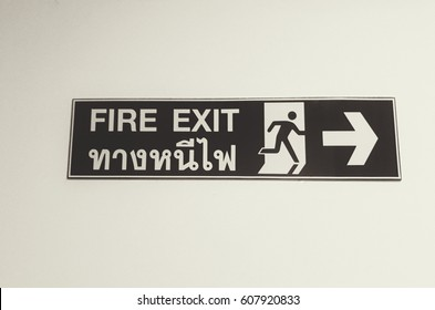 Black and white pattern, Fire exit sign in English and Thai language.