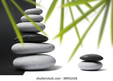 Black and white pebbles arranged in stacks with nice balance and a split black and white background