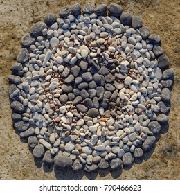 Black and white pebbles in circle. Zen meditation of rock garden concept