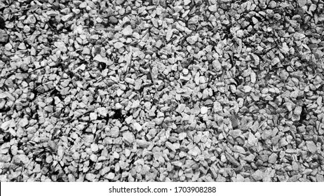 Black and white pebbles texture background