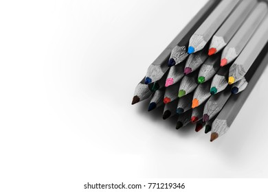 Black and white pencils among pencil colored hearts. Shallow depth of field