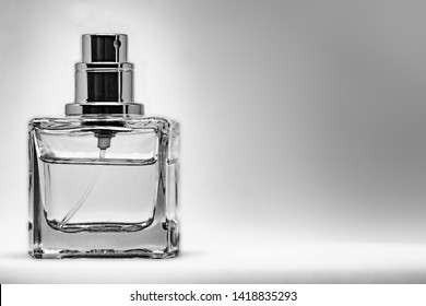 Black and white Perfume glass bottle on white background. eau de toilette. eau de parfum. Parfum